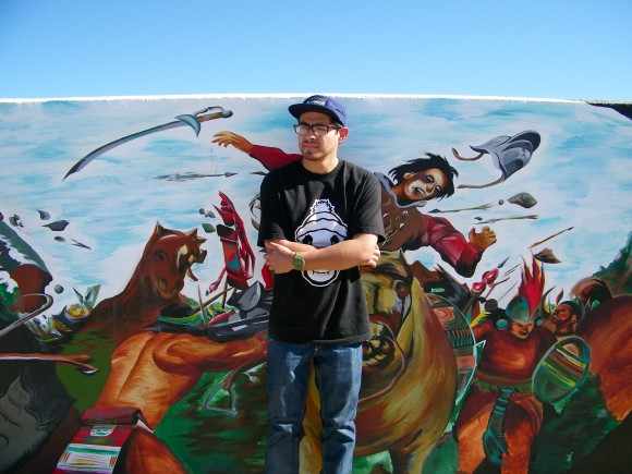 Chris Sanchez at the Shady Lane Mural, photo by Sarah Scheideman